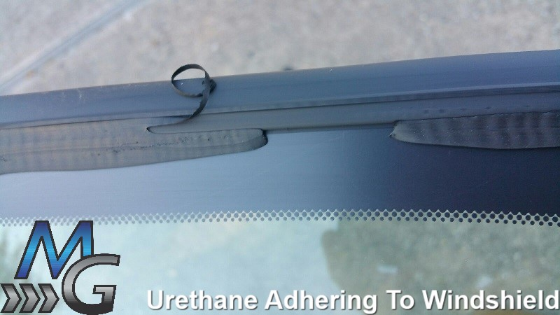 Once urethane adheres to a windshield it's almost impossible to remove